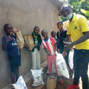 Donatien, RDO in Rusizi district, distributes food to 5 families