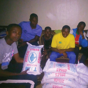In Gasabo district, RDO, Jean de Dieu, distributed flour to some families in his district