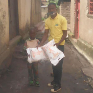 In Nyamasheke, Frederic provided large sacks of maize flour and other foodstuffs to children and their families