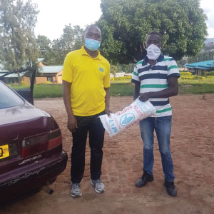 Kamanda, our programme manager, presented a sack of maize flour to families that play for the Alfa rugby club in Kigali