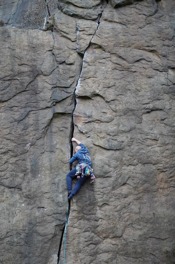 Stuart Hutchinson climbing at Millstone Crag on the edge of the Peak District